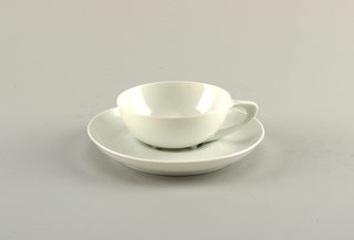 White porcelain cup and saucer with a simple open form.