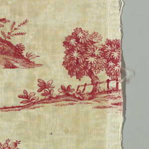 Panel, once part of a valance, and small fragments of white cotton with large, scenic design printed in red. Design is incomplete and shows a central pillar twined with a grape vine. At the base, a woman in flowing robes over armor is seated with one hand on her breast, the other pointing to the right. Beside her stands a young man, Bacchus, a wreath of grapes in his hair, the thyrsus entwined with grapes in his left hand, and in his right hand, a wine cup which he offers to the woman. At back, architectural details such as a lighthouse, a galley under full sail, with oars. At right, a rustic scene of a girl dancing while a piper plays. On Component B, lower right, a naked boy crowned with grapes on the back of a leopard. Additional details include: wine pitcher, vase, foliage and birds.