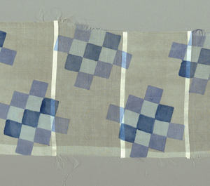 Four samples with different color schemes. Blocks of checkerboard pattern printed over a woven stripe alternating sheer and opaque, separated by narrow bands of satin. Both selvedges present on all samples.