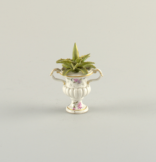 Figure of a Plant in an Urn Figure
