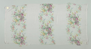Textile sample with a pale pink ground has three broad vertical columns of densely massed small roses and other flowers. Both selvedges present on all samples.