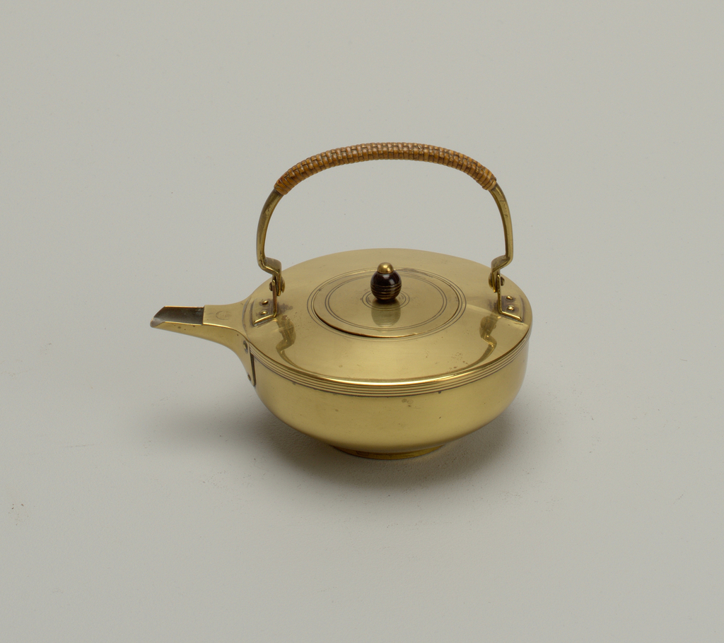 Three-legged stand (c) with pierced lower frame for lamp and upper frame to support kettle. Legs attached to frame with three copper rivets. Upperframe recessed to hold pierced grill (d). Pressed glass candle lamp (e) fitted with brass cover with flange handle (f). Grill tinned on underside.