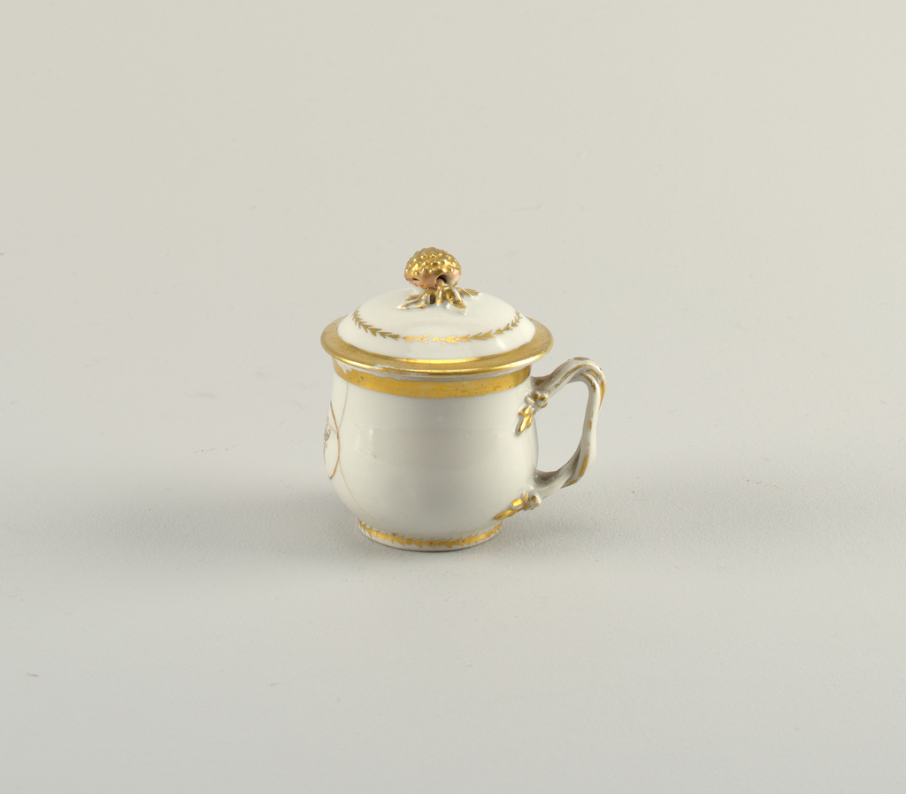 Porcelain cup and cover (Pot de Crème) with a decorated handle and gilt initials belonging to a serving set.