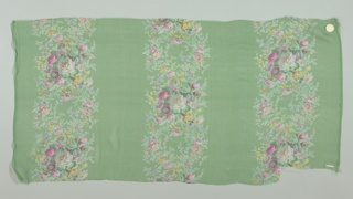 Textile sample with a bright green ground has three broad vertical columns of densely massed small roses and other flowers. Both selvedges present on all samples.