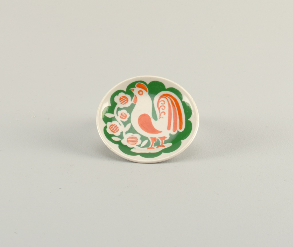 A rooster painted in center in green and orange.
