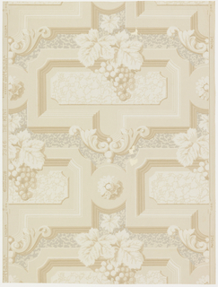 "An architectural design of horizontal rows of rectangular plaques with heavy moldings on edges, Rococo scrolls on center of bases. Connected with paterae. Bunches of grapes festoon top. The background simulates rusticated stone.  The original of this wallpaper was in the hall of old brick tavern of Kents Corner, Calais, Vermont. Printed in selvedge: ""The Kent, 7436, Strahan Made in U.S.A."" Printed in ivory and tan on light tan field."