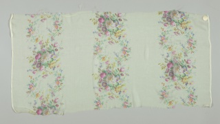Textile sample with a pale yellow ground has three broad vertical columns of densely massed small roses and other flowers. Both selvedges present on all samples.