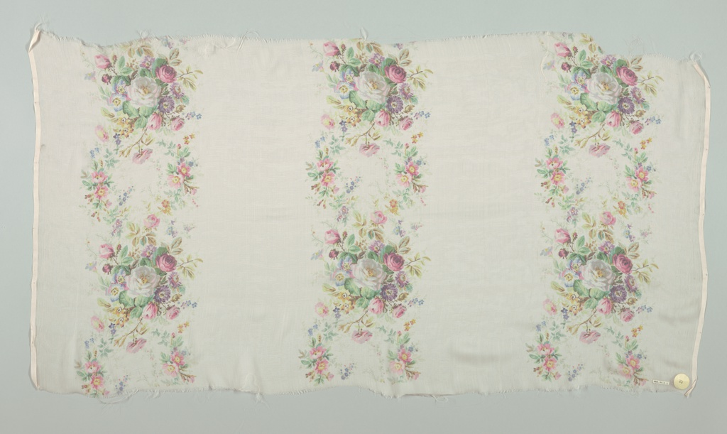Textile sample with a blush-colored ground has three broad vertical columns of densely massed small roses and other flowers. Both selvedges present on all samples.