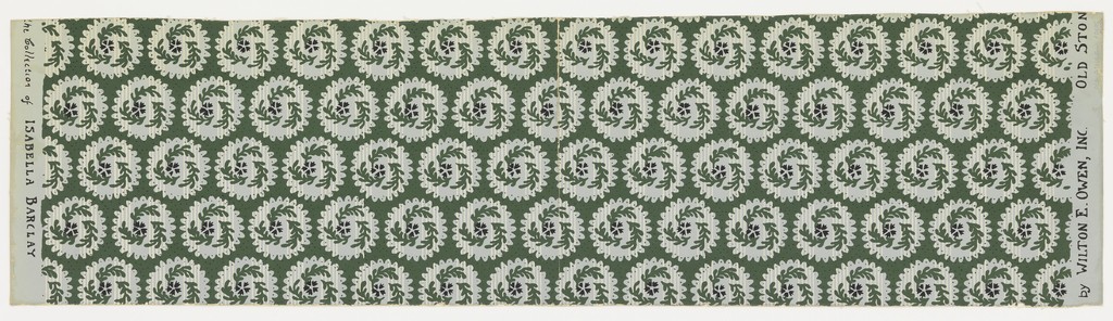 Alternating rows of saw-toothed circles which contain white stripes and green sprigs. Printed in dark green, white, black on pale green.