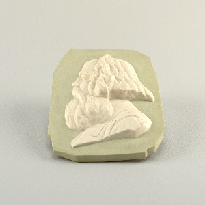 Rectangular with irregular corners, greenish background, white bust of Karl Marx in profile in relief