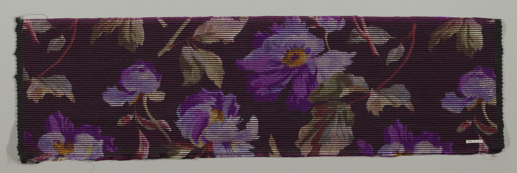 Heavyweight silk with horizontal ribbing has large-scale purple and yellow pansies scattered over a black ground.