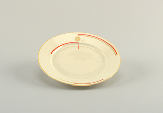 Round plate with flat marli decorated with light orange line of glaze at rim and partial circle of bright orange glaze within.