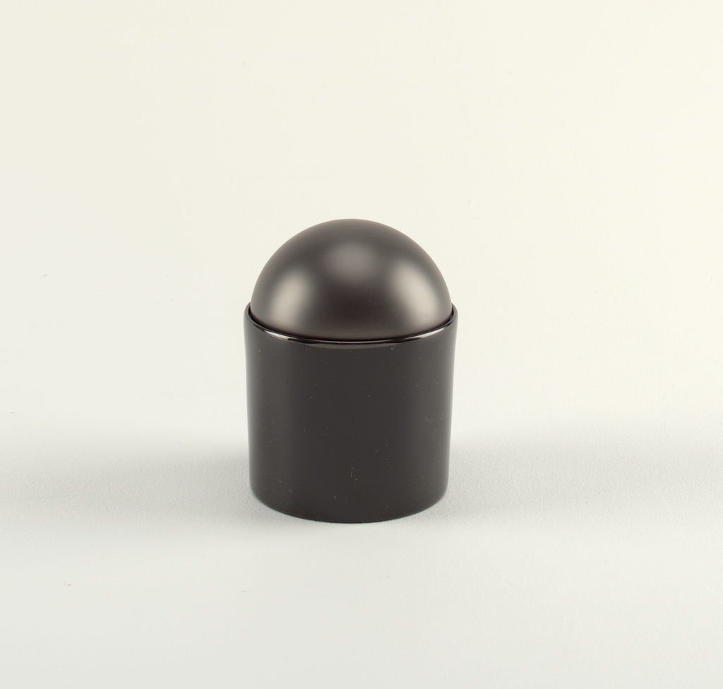 Black sugar bowl with bowl-shaped cover.