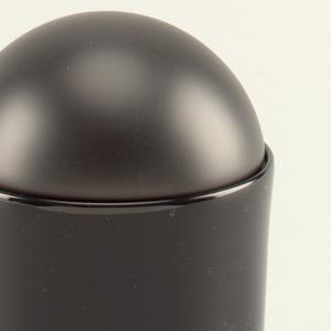 Black sugar bowl with bowl-shaped cover.
