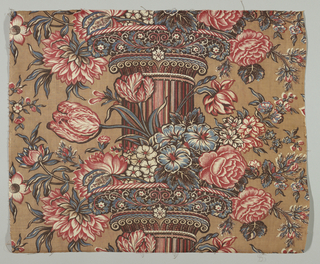 Multicolored pillar print with a single fluted column and capitals of scrolling flower and vine motif in a symmetrical arrangement. Capitals are festooned with flowers like roses and tulips.