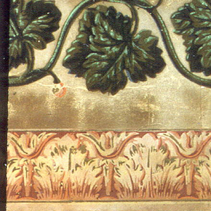 Acanthus and bead moldings at top. Below, a serpentine band of grape leaves in green flock.