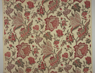 Polychrome block print on white natural linen. Serpentine branches with fantastic flowers in red, pale blue with patterned petals and wild scrolling leaves in red and green. Pattern repeats in one-half drop. Condition: soiled