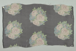 Staggered horizontal repeat of round mass of pink and blue roses and asters on a black ground. Both selvedges present on all samples.