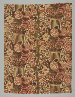 Short panel of a chintz pillar print in shades of brown, red and yellow. Short, fluted pillar with Corinthian capital appears at intervals in two vertical rows, surrounded by naturalistically rendered flowers and foliage.