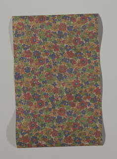 Field almost entirely covered with small blue, green, yellow and orange flowers, with gold flecks overprinted. Intended for women's shoes.