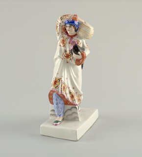 Woman dressed in colorfully patterned tunic and trousers, blue turban, strides forward with right foot, right arm over head holding basket on left shoulder, a hen in her left arm; rectangular base.