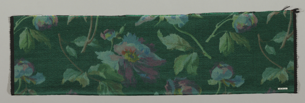 Heavyweight silk with horizontal ribbing has large-scale multicolored pansies scattered over a dark green ground.
