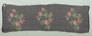 Sample with a black ground with repeating rows of a life-size spray of roses in shades of red and yellow.