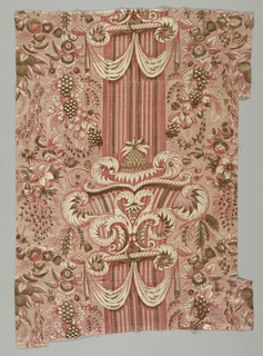 Pillar print of pink and olive green showing a single fluted column in the center. Column is decorated with exuberantly scrolling capitals and drapery swags. On either side are leafy plants, flowers, and fruits.