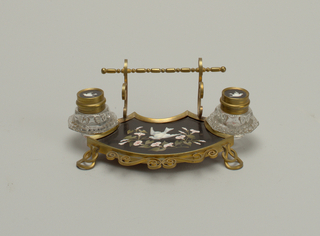 Inkstand with two containers. Brass scrollwork and inlaid decoration of dove and florals.