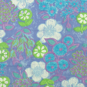 All-over natural size floral pattern screen printed in light green, mauve, green-blue and white with grey-blue ground. Liberty tag attached. Both selvedges present.