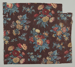 Naturalistic flower sprays of roses, poppies, etc.; block-printed in red, drab, blue and faded yellow, on aubergine background, probably put in with roller.