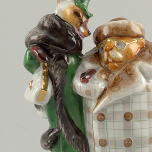 Beaver dressed in plaid fur-trimmed coat and fur cap holds briefcase in left hand; next to him a fox dressed in green fur-trimmed coat, green hat, holding white handbag; circular base.