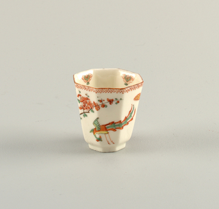 A pair of octagon cups with a thin red border around the lip of the cup both painted with a birds in an outdoor scene.
