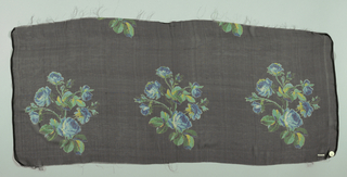Sample with a black ground with repeating rows of a life-size spray of roses in shades of blue and yellow.