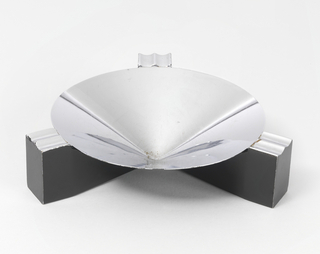 ashtray with three black legs