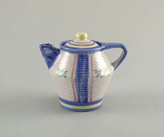 Ribbed teapot with thin hand-painted glaze in blue, pink and pale yellow. Domed lid with yellow knob finial.