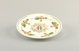 "Circular, with eight-pointed medallion in center inscribed (in Russian) ""1952 / 8 / March;"" surrounded by border of orange flowers with leaves; thin gilded double outer band"