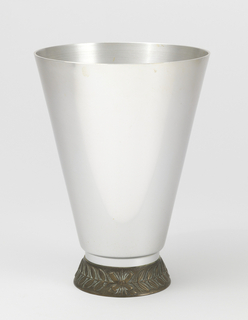 Tall conical vase tapering at the bottom. Base has laurel leaf decoration
