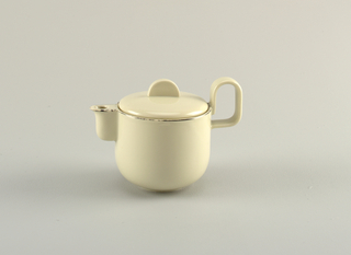 "Creamy-grey porcelain body. (a) Milk jug is cylindrical in shape, with curved lower section that tapers to circular foot. Spout is upright, curved and cylindrical, attached along the entire length of the spout. Handle is placed high on body, formed like upright reversed ""U."" (b) Cover is slightly domed, fitted with flange for closure, with flat semi-circular upright finial. Platinum band painted around lip and spout."