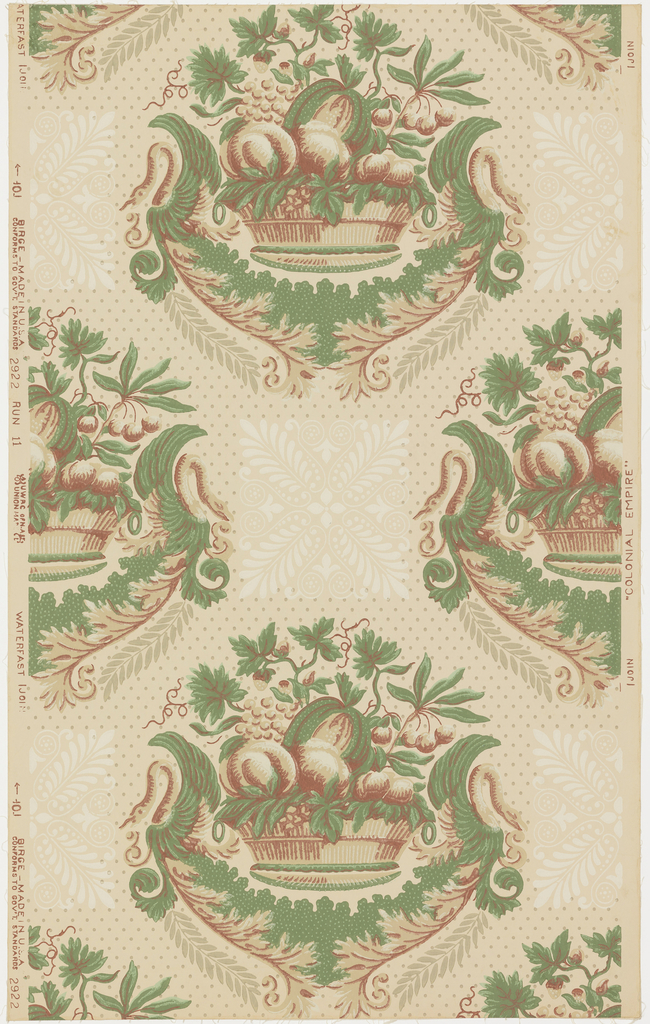 "A basket of assorted fruit which repeats in alternating rows. Between each repeat is a square stylized leaf motif in ivory. Field of paper covered with dots in diagonal rows. The design is suggestive of the Empire period. A reproduction of a paper from the old Rockwell homestead at Holland Patent near Utica, New York. Original printed prior to 1810. Printed on reverse: No. 226 CB"". Printed in green, old red and ivory on beige field."