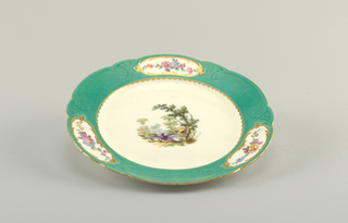 Marly divided into six parts with molded relief scrollwork, and three oval reserves with florals are outlined in gilding, against a green ground. At center, hand-painted birds and trees.