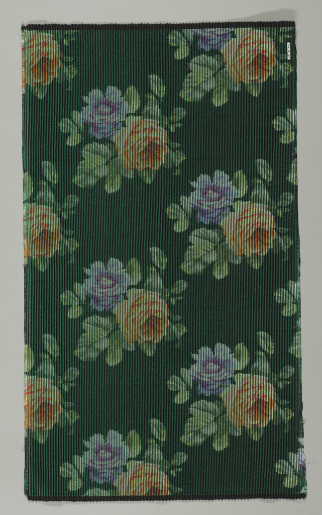 Heavyweight silk with horizontal ribbing has large-scale violet and orange roses scattered over a dark green ground.
