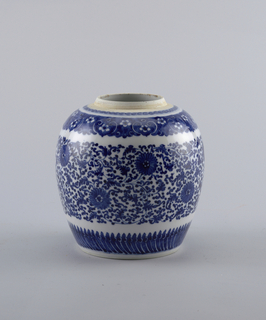 Ginger jar. Blue and white. Ovoid, the blue underglaze decoration in four bands, the widest through the body consisting of floral scrolls and chrysanthemum blossoms. Lotus petal border at the base. Chien Lung.