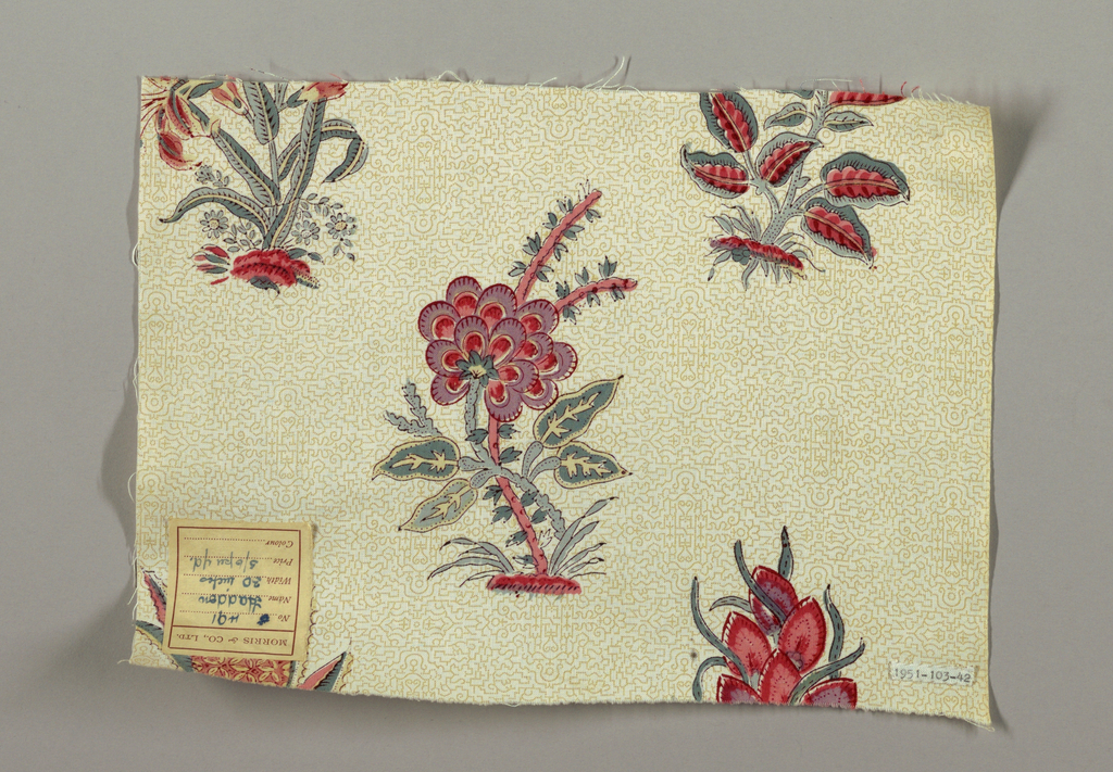 Medium-scale design of exotic flowers fairly widely set in offset layout, in pinks, lavender, blue-green with black outlines and white ground with a small tan all-over pattern based on Persian rug medallions.