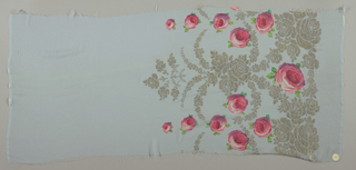 Sample of a solid pale blue ground has a wide border design of printed pink roses and green leaves with swags, garlands, and spires in brocaded gold thread.