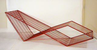 Red lounge chair (A) with 1 roll neck cusion (B) and 3 thin triangular cushions (C/E)