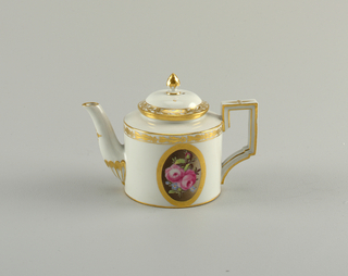 Cylindrical; strap handle of rectangular form; concave spout; slightly domed shoulder and cylindrical collar; domed cover with flame finial. Oval floral medallions and gilded bands. Bottom unglazed.