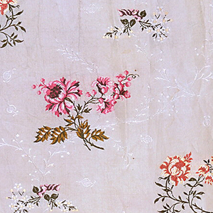 Sprigs of flowers tied with bows, horizontally offset, in shades of pink on a white ground. Secondary monochrome pattern of white sprigs.