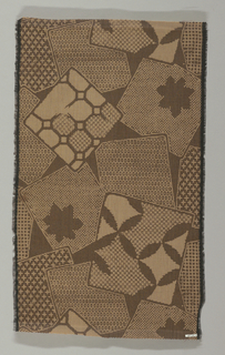 Design in brown, tan and black of overlapping squares and rectangles that contain large and small-scale geometric patterning .