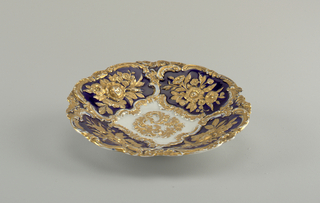 Dark blue ground with gilded floral relief ornament.